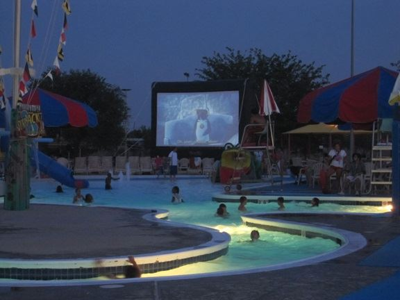 Movie Projected on a Screen Beside the Lazy River