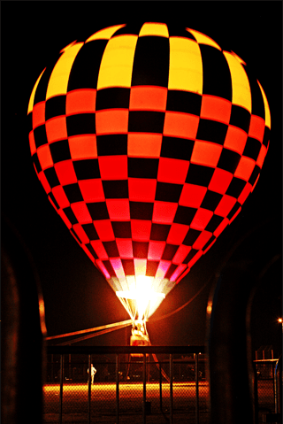 Orange and Yellow Hot Air Balloon Illuminated at Night
